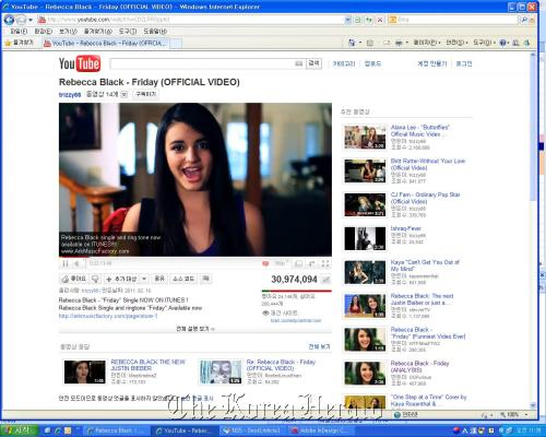 """A screen capture shows Rebecca Black singing """"Friday"""" in her YouTube video clip. (YouTube)"""