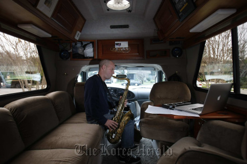 """Nomadic composer and saxophonist Glenn Morrissette, 41, writes and performs on the road, emailing his scores to shows such as """"Family Guy,"""" from his RV. (Los Angeles Times/MCT)"""
