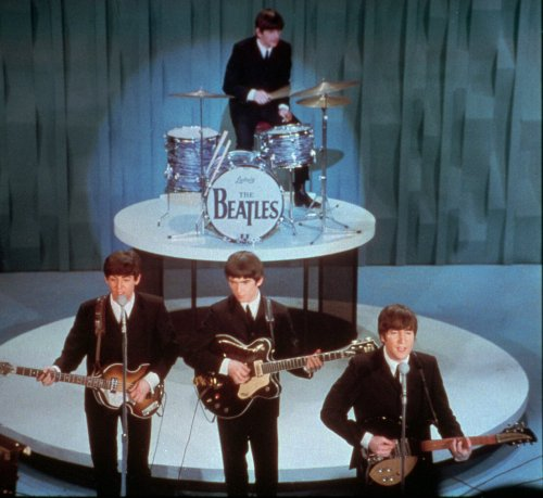 """The Beatles (front row from left) Paul McCartney, George Harrison, John Lennon and Ringo Starr on drums, perform at the """"Ed Sullivan Show,"""" in New York. (AP-Yonhap News)"""