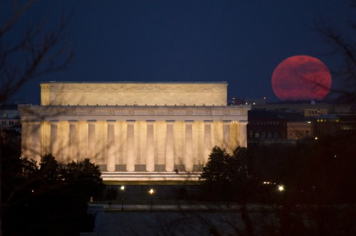 The full moon is seen as it rises near the Lincoln Memorial, Saturday, March 19, 2011, in Washington. The full moon was called a