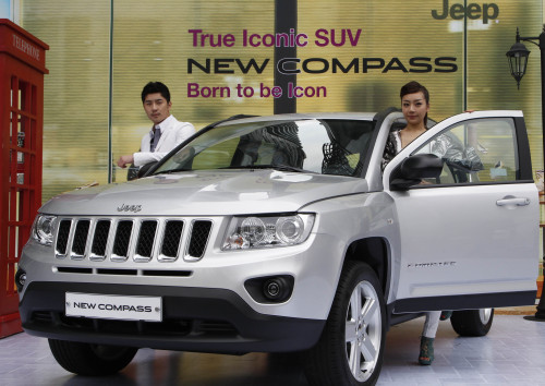 Models pose with the compact sport utility vehicle New Compass released by Chrysler Korea last month. (Yonhap News)