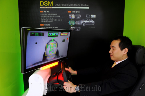 A visitor tries the driven-state monitoring system simulator.