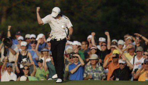Rory McIlroy celebrates after making a birdie on the 17th hole. (AP-Yonhap News)