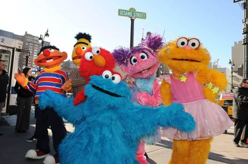 "Sesame Street Live characters (left to right) Ernie, Bert, Elmo, Abby Cadabby, Zoe and Cookie Monster (front) celebrate the renaming of the corner of 31st Street and Eighth Avenue to ""Sesame Street"" outside Madison Square Garden in New York in February 2010. (AFP-Yonhap News)"