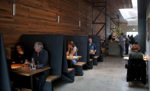 Bar Agricole in San Francisco is bright and spacious, but the tall booths provide intimacy for diners. (Los Angeles Times/MCT)
