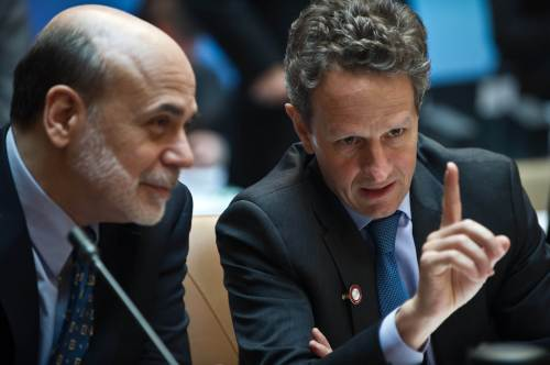 U.S. Treasury Secretary Tim Geithner (right) chats with Federal Reserve chairman Ben Bernanke before the start of the G20 finance ministers and central bank governors meeting at the IMF/World Bank Spring meetings in Washington on Friday. (AFP-Yonhap News)