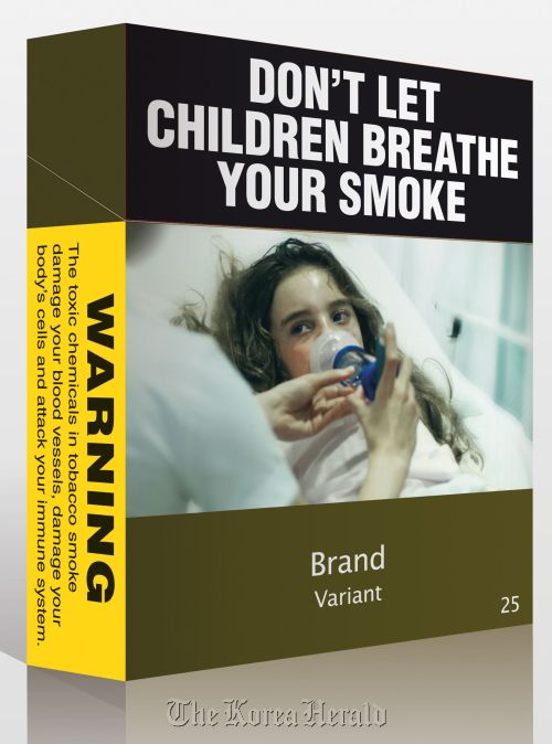 The new compulsory cigarette packet is plastered with health warnings. (AFP-Yonhap News)