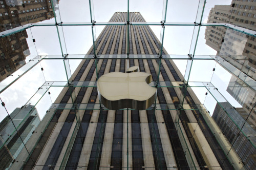 An Apple Inc. logo hangs above the entrance at the Fifth Avenue store in New York. (Bloomberg)