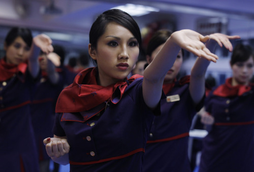 Cabin crews from Hong Kong Airlines practise Wing Chun, a concept-based Chinese martial art or Kung Fu, during a lesson in Hong Kong Saturday, April 30, 2011. A Hong Kong airline makes all its cabin crews to take Wing Chun lessons as helping them to build the team spirit and to learn self-defense. (AP-Yonhap News)