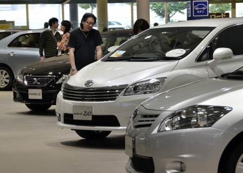 Toyota vehicles are displayed at a showroom in Tokyo. (AFP-Yonhap News)