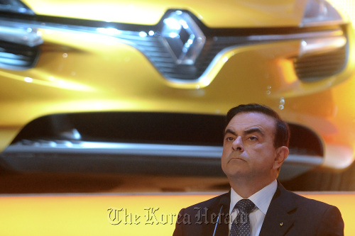 Carlos Ghosn, CEO of Renault SA, listens during the company's annual general meeting at the Palais des Congres in Paris last month. (Bloomberg)