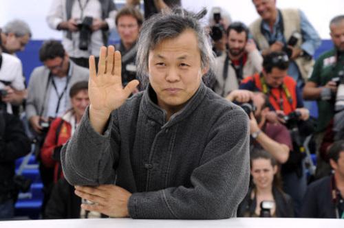 Director Kim Ki-duk poses during the photocall of
