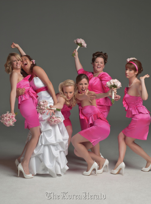 """From left: Kristen Wiig, Maya Rudolph, Wendi Mclendon-Covey, Rose Byrne, Melissa McCarthy and Ellie Kemper star in the new comedy, """"Bridesmaids,"""" from Universal Pictures. (MCT)"""