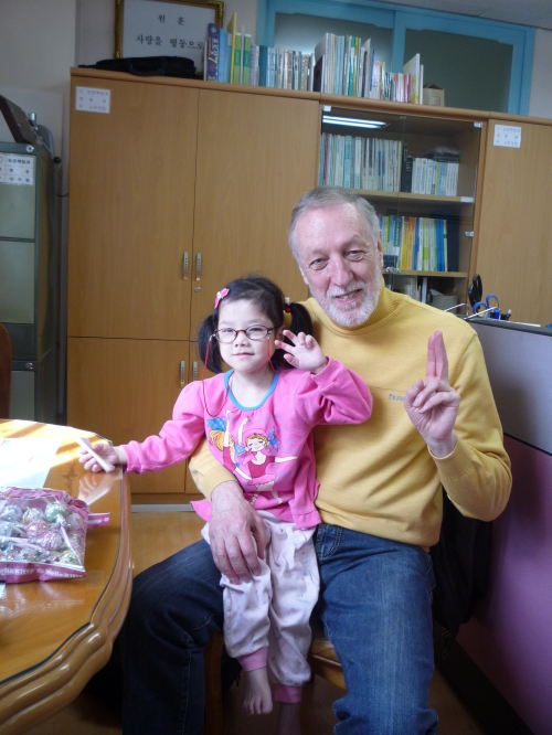 Terry Lyons with orphan Esther Park ahead of walking a marathon to raise cash for her expensive medication