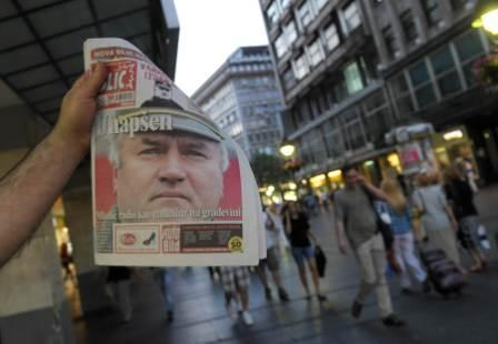 A street vendor displays tomorrow's Serbian newspaper with the headlines about Ratko Mladic's arrest in Belgrade on May 26, 2011. Serbia today announced the arrest of former Bosnian Serb military chief Ratko Mladic, ending a 16-year manhunt for the general accused of masterminding the Srebrenica massacre, Europe's worst since World War II. (AFP)
