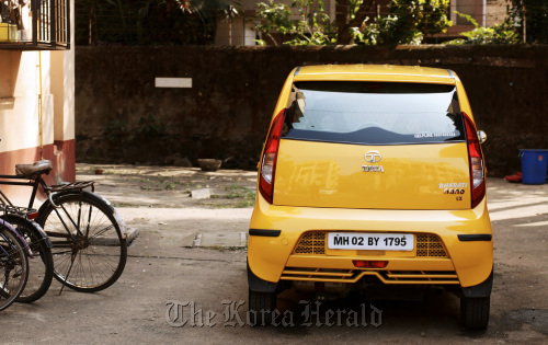 A Tata Motors Ltd. Nano automobile parked in front of a building in Mumbai, India. (Bloomberg)
