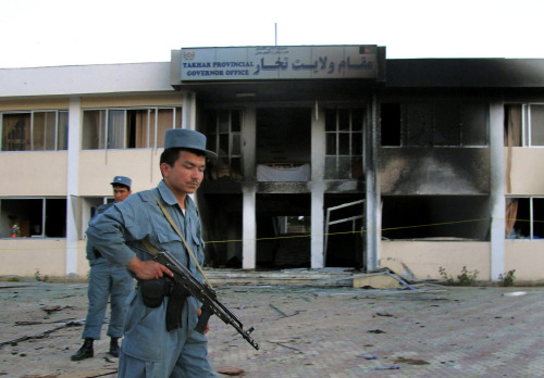 Afghan security stand at the site where a suicide bomber blew himself up inside the provincial governor's compound in Taloqan, Takhar province, north of Kabul on Saturday.(AP-Yonhap News)