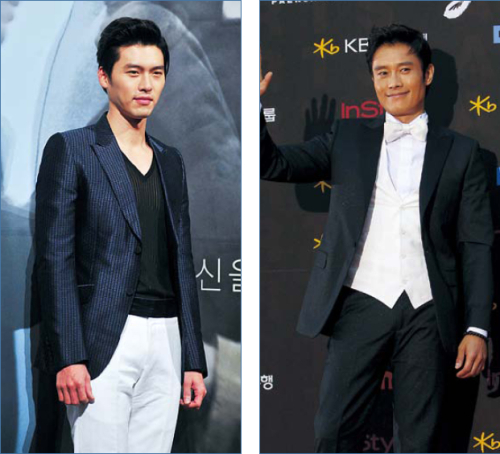 "(Left) Hyun Bin poses during a premiere of movie ""Late Autumn"" in February. (Yonhap News)(Right) Lee Byung-hun poses during the Paeksang Arts Awards ceremony Thursday. (Yonhap News)"
