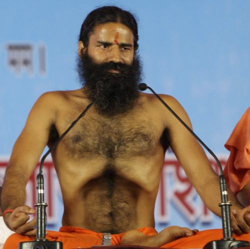Renowned yoga guru Baba Ramdev performs Yoga exercises before going on a hunger strike with his followers in New Delhi on Saturday. (AP-Yonhap News)