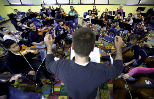 Arturs Weible, Lafayette Specialty School music teacher, conducts a rehearsal for an after-school orchestra in Chicago. (AP-Yonhap News)