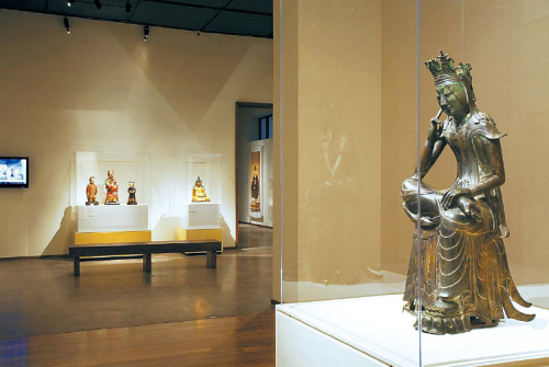"""A view of LACMA's Korean gallery featuring """"Pensive Bodhisattva,"""" a late 6th century sculpture. (2009 Museum Associates/LACMA)"""