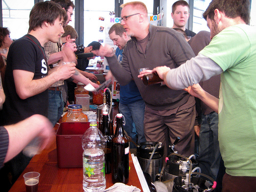 Participants talk over some homebrewed beer at the first Fermentation Celebration at Craftworks Taphouse and Bistro in Itaewon. (Jason Lindley)