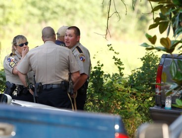 Law enforcement officials are on the scene of a home in Hardin, Texas Tuesday, June 7, 2011, after receiving an anonymous tip that multiple dismembered bodies were buried there. A sheriff's spokesman said officials were seeking a search warrant for the property. (AP)