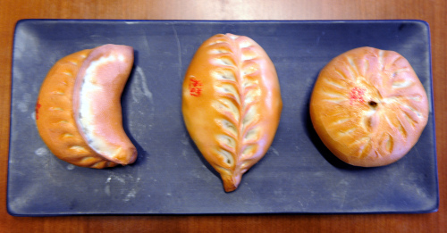 Zhiwei's signature oven-baked dumplings come in three flavors — (from left) seafood, meat and vegetable. (Kim In-su/The Korea Herald)