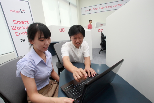 "KT employees work at a ""Smart Working Center"" the company installed in Bundang, Gyeonggi Province. (KT)"