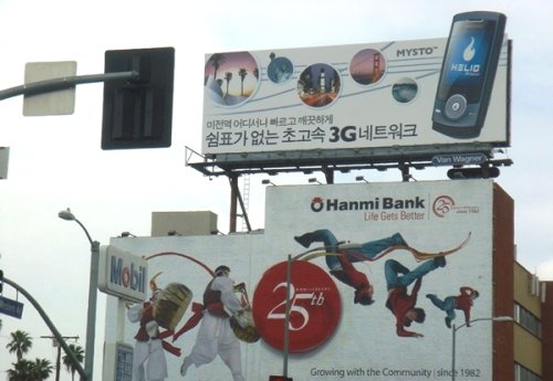 A billboard advertising SK Telecom's Helio 3G telecommunications network service in the U.S. is shown in Korea Town in Los Angeles.