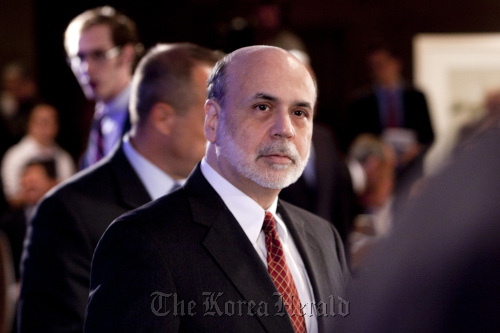 Ben S. Bernanke, chairman of the U.S. Federal Reserve, arrives to speak at the Committee For a Responsible Federal Budget annual conference in Washington, D.C. on Tuesday. (Bloomberg)