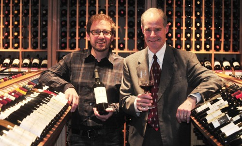 Independent vintner and Dana Estates winemaker Philippe Melka (left) and Dana Estates vice president Pete Perry enjoy a glass of 2008 Onda d'Oro at Podo Plaza in Seoul on Wednesday. (Kim Myung-sub/The Korea Herald)