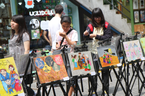 People look at winning pictures from the Europe-Korea Foundation's Autistic Children's Drawing Contest in Seoul. (EFK)