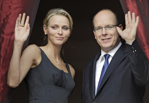 Prince Albert II of Monaco and his fiancee Charlene Wittstock attend to the St Jean Religious Parade , Thursday, June 23, 2011, in Monaco. Prince Albert II of Monaco and his fiancee Charlene Wittstock of South Africa, will wed on July 1 and 2.(AP-Yonhap News)