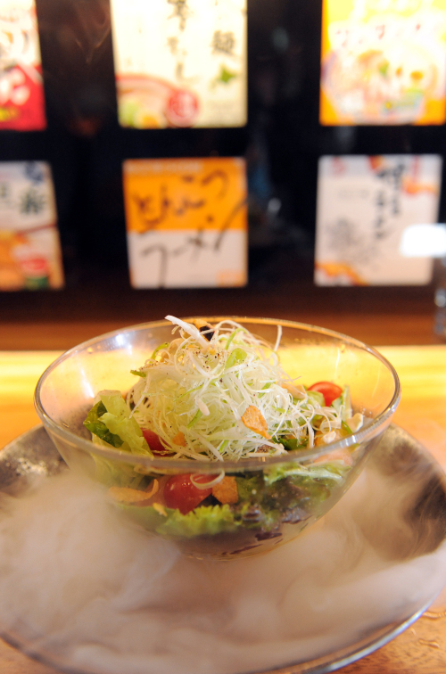 Ippudo Seoul serves up their citrusy ramen salad over a bed of dry ice, making the experience of slurping cold, house-made noodles all the more refreshing. (Ahn Hoon/The Korea Herald)