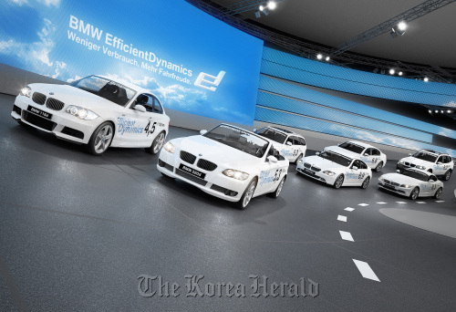 Cars are seen on BMW's indoor test track at the Frankfurt International Motor Show in Germany, 2009.  (Bloomberg)