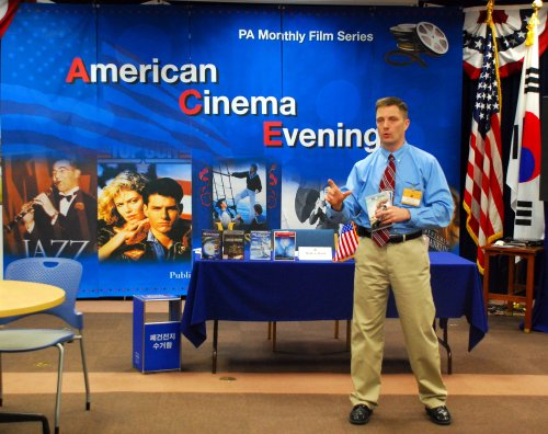 """U.S. Embassy deputy facility management officer Mark Dowd discusses environmental issues after watching the movie """"The Age of Stupid"""" during the America Cinema Evening's monthly gathering in April. (U.S. Embassy)"""