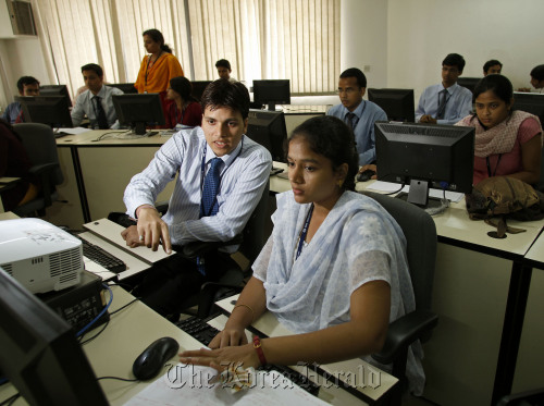 Engineering recruits undergo training at the Tata Consultancy Services Ltd. training center in Trivandrum, India, on May 24. (Bloomberg)