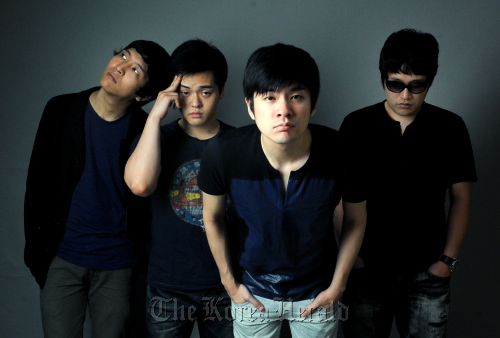 Indie band Chang Kiha & the Faces members, minus guitarist Lee Min-ki, pose for a photograph before an interview in Seoul on June 29: (From left) Jeong Jung-yeop on bass, Kim Hyun-ho on drums, Chang Ki-ha on vocals and Lee Jong-min on keyboards.(Park Hyun-koo/The Korea Herald)