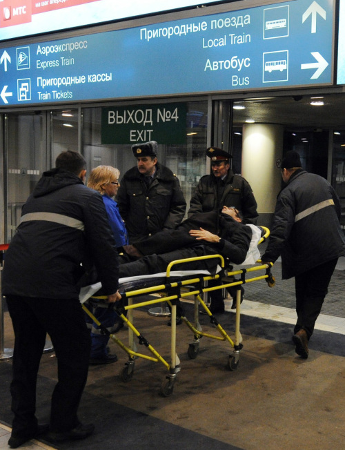 A bombing victim is wheeled by paramedics from Domodedovo International Airport. (MCT)