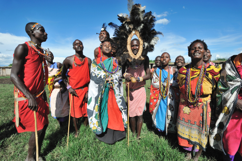 Maasai people welcome guests.
