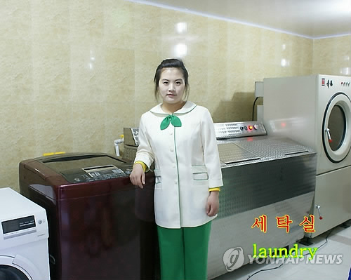 A North Korean worker poses at a laundry room of a luxury restaurant-leisure resort opened in Pyongyang in a joint venture with a European company.(Yonhap)