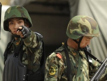 Armed Chinese paramilitary police officers are seen on guard in Urumqi.(AFP)