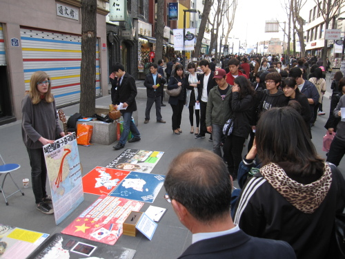 A Justice for North Korea volunteer talks at an event in Insadong earlier this year. (JFNK)
