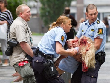 A young victim is helped in the center of Oslo, Norway on Friday, July 22, 2011, after a bomb ripped open buildings in the heart of Norway's government. (AP)