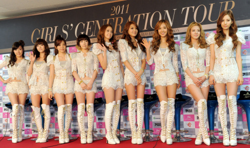 Girls' Generation pose before a press conference in Seoul on Sunday. Ahn Hoon/The Korea Herald