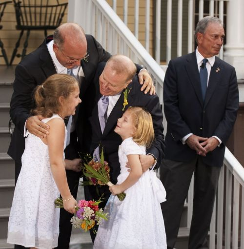 Newly-wed gay couple along with their daughters hug each other on Sunday. (AFP-Yonhap News)