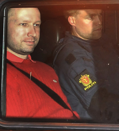 Norway's twin terror attacks suspect Anders Behring Breivik, left, sits in an armored police vehicle after leaving the courthouse following a hearing in Oslo Monday July 25, 2011 where he pleaded not guilty to one of the deadliest modern mass killings in peacetime. (AP)