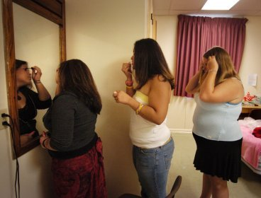 This file photo showsobese women checking their looks in front of mirror. (MCT)