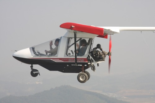 An instructor and a rider enjoy a ride on a light airplane. (Hwaseong City)